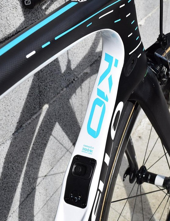 The black and white frameset has constrasting electric blue decals