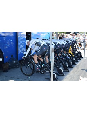 Team Sky warm-up in unison ahead of the stage