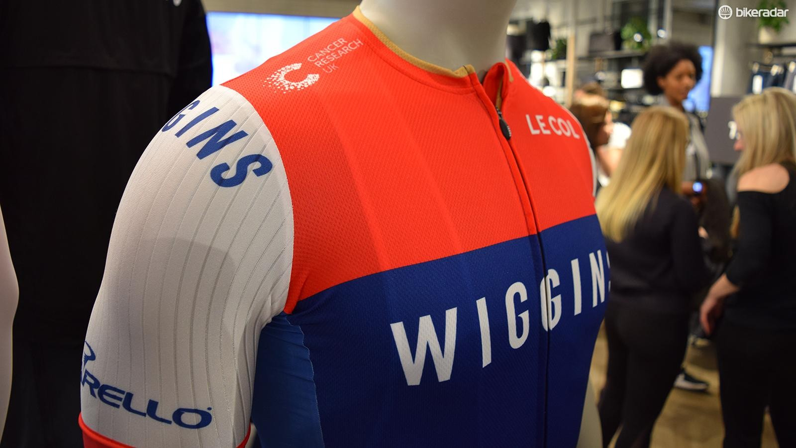 The jersey features an aggressive neck line with a touch of gold