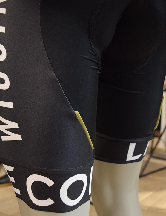 White lettering and more flashes of gold feature on the black bibshorts