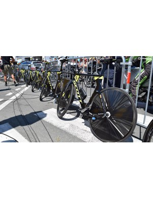 Mitchelton-Scott's Scott Plasma time trial bikes sit against the fence ahead of their team time trial effort, each rider was equipped with a Lightweight Autobahn rear wheel