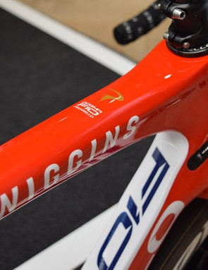 The bright red design has constrasting white decals that share a similar design to the new team jerseys