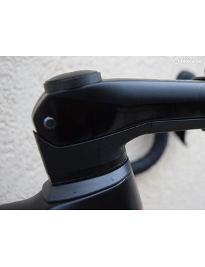 An integrated cockpit system allows front end adjustment while keeping the cables hidden away