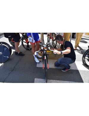 UCI commissaires checked every single bike with a tablet for technological fraud ahead of the stage