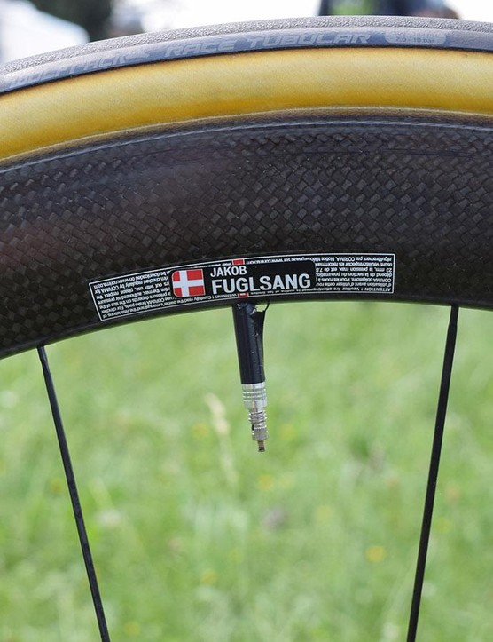 Fuglsang's race wheels are labelled up with his name and the Danish flag