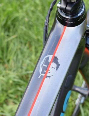 Fuglsang's face is split with an Iron Man design at the head of the top tube