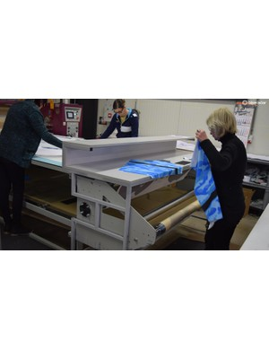 Each panel of each custom jersey is taken off the printer manually, bundled together and then sent to the stitching room