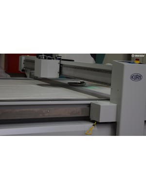 A cutting machine cuts the correct size panels for a corresponding jersey size