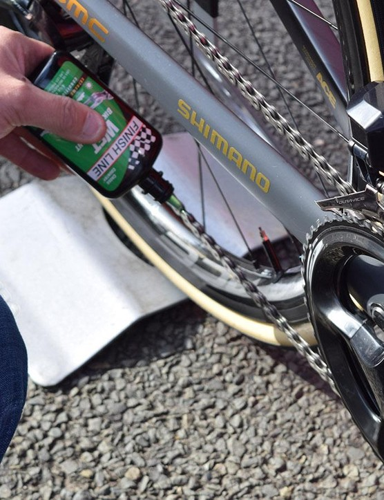 Last minute chain-lubing for maximum drivetrain efficiency during the race