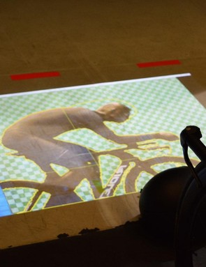 A projector shows the rider's silouhette on the floor so they can alter their position while using the tunnel