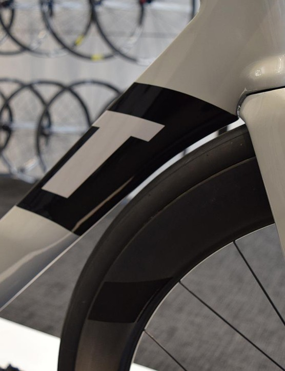 There is also a small curvature on the head of the down tube to allow for the front tyre