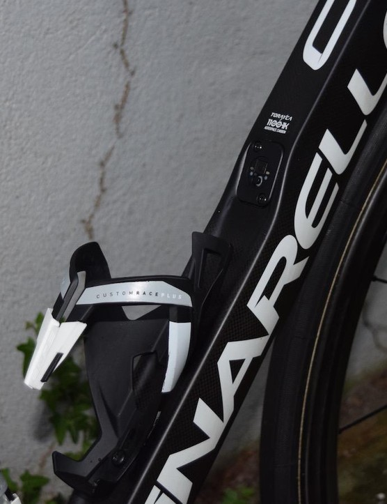 The Pinarello Dogma F10 features a concave downtube, which allows the bottle cage to protrude from the frame less