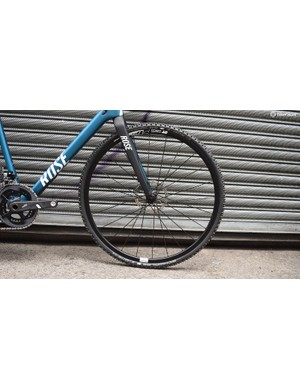 While the wheels are the same model front and rear, the bike is equipped with a grippier Schwalbe X-One Evo Bite at the front