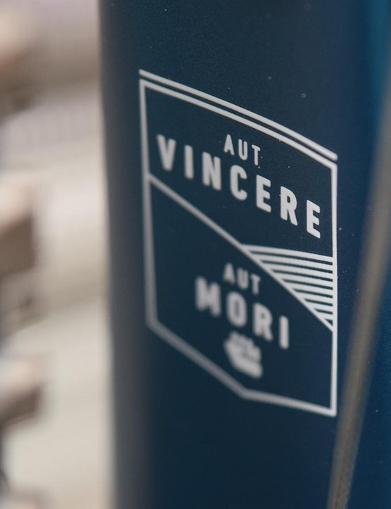 Aut Vicenre Aut Mori' sits on the down tube in the rear wheel well area, which means 'to conquer or to die' in latin