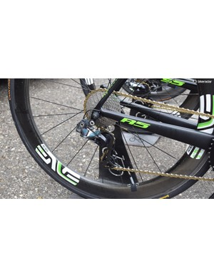 The Dimension Data drivetrains stand out among the peloton with gold KMC chains, Rotor and Shimano components