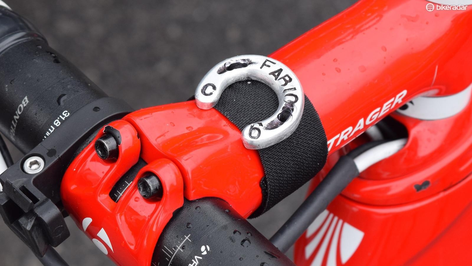 Early race leader Fabio Felline has a lucky horseshoe on his stem