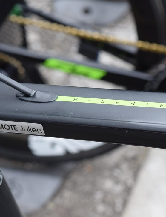 Green decals stand out on the raw carbon finish of the frameset