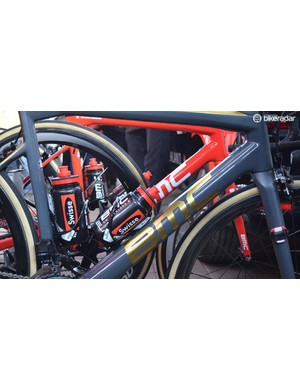 The base paint of the frame is a matte dark grey, while the gold decals for the Olympic champion catch the eye