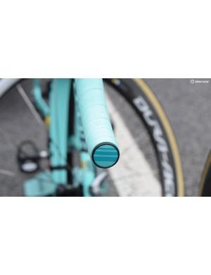 Roglič's subtle celeste handlebar ends are different to the rest of the Lotto-JumboNL team