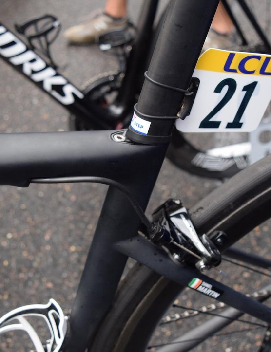 The seat post clamp is positioned on the top tube and is likely a wedge system