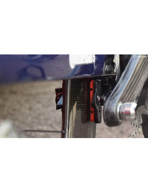 The rear brake is positioned underneath the bottom bracket