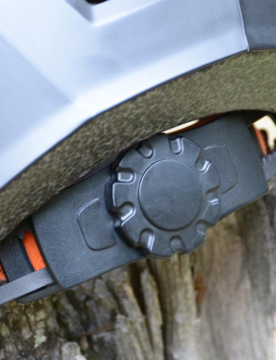 The dial is workable with one hand, but is hard to adjust as the top of the dial sits under the helmet