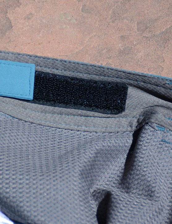 The waist adjusters are cleanly integrated on the inside of the waistband