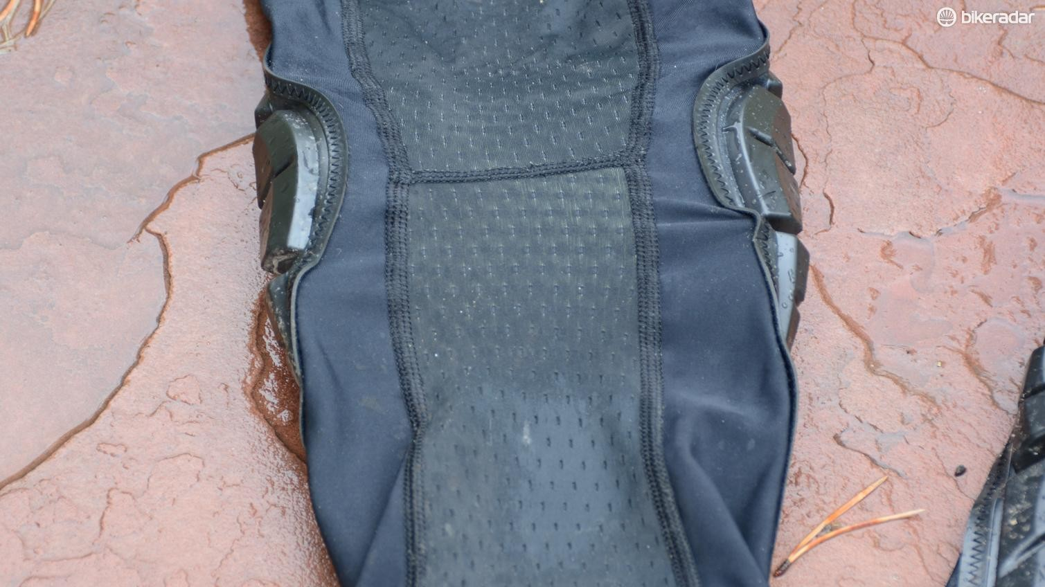 Mesh on the back prevents bunching of the material while pedaling and provides some ventilation