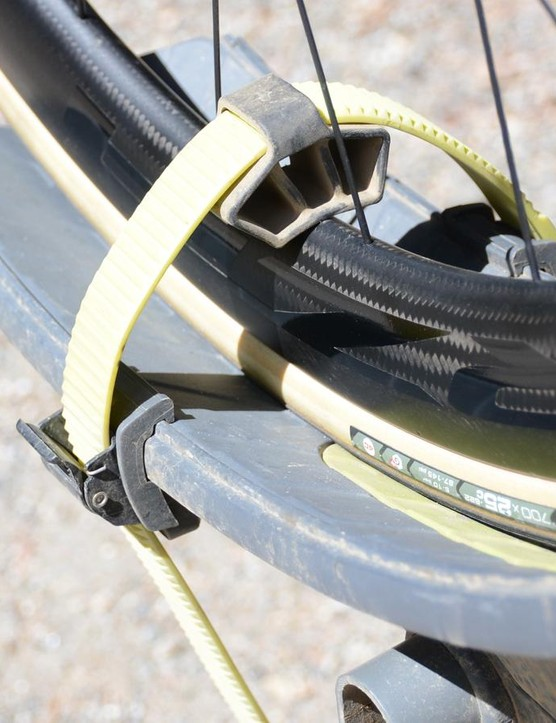 The wheel straps are 44.4cm (17.5in) long to work with the tallest aero rims and the widest fat tires. The rubber spacer takes up the space on thinner wheels