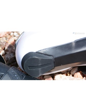 A large rear heel tab is present for off-bike manoeuvring
