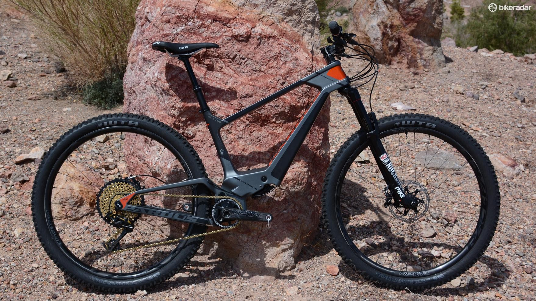 This is not an electric bike, it's a new full-suspension bike with the rear shock tucked inside the frame