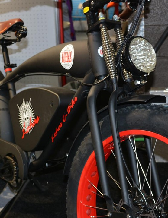 Even without a motor and battery, this retro moto cruiser would still be a heavyweight with the fat wheels, springer fork, monster saddle and large headlight