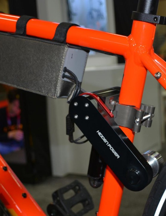 The battery straps to the top tube, the powering arm pivots off of the seat tube, and a tiny throttle controls it all