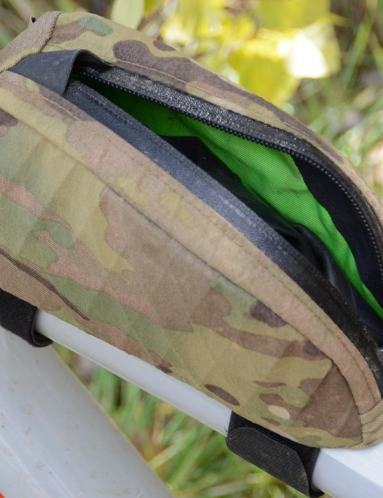 The interior is a bright yellow and the sides have hard plastic inserts so the bag stays upright