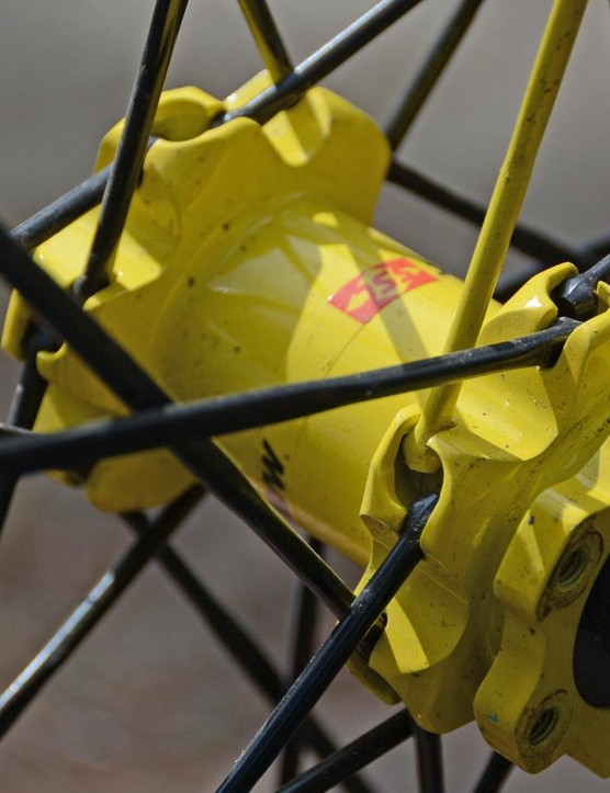 24 aluminum spokes protrude from both the front and rear hubs