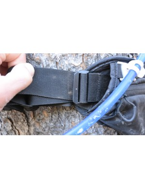 An additional buckle locks the waist adjustment in place