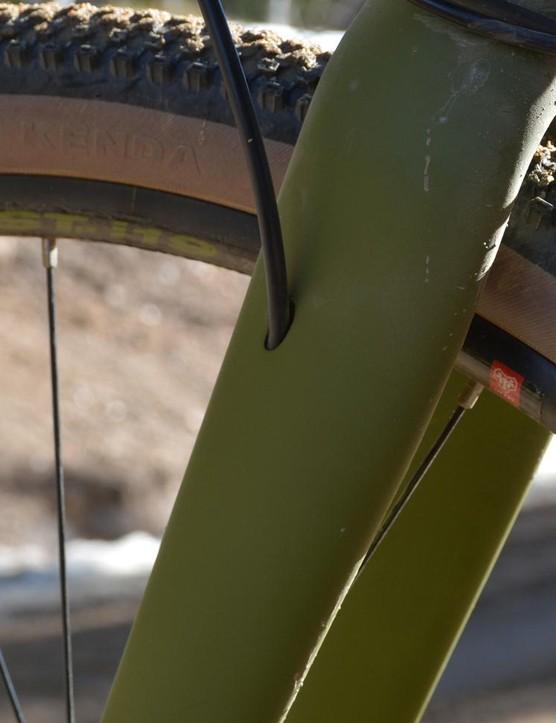 Front brake hose routing goes through the left fork leg