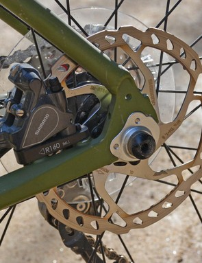 The rear axle is 12mm thru, the caliper is a flat mount, and there's a 160mm disc out back
