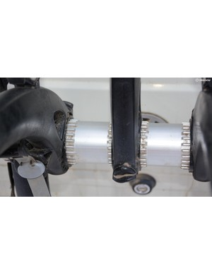 The silver center cylinder allows for almost infinite adjustment of the feet that press against the vehicle and of the bike-holding arms