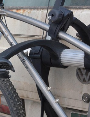 The second/outer bike arm can go through the main triangle of the first/inner bike or over the top tube