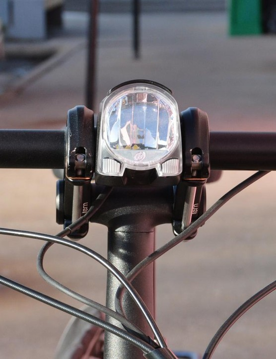 Headlight and taillight are included, turn indicators are still up to the rider however