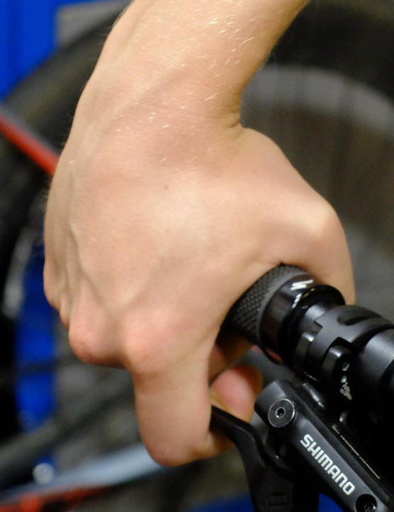 Pointing your brake levers too far down rolls your wrist over the top of the bars