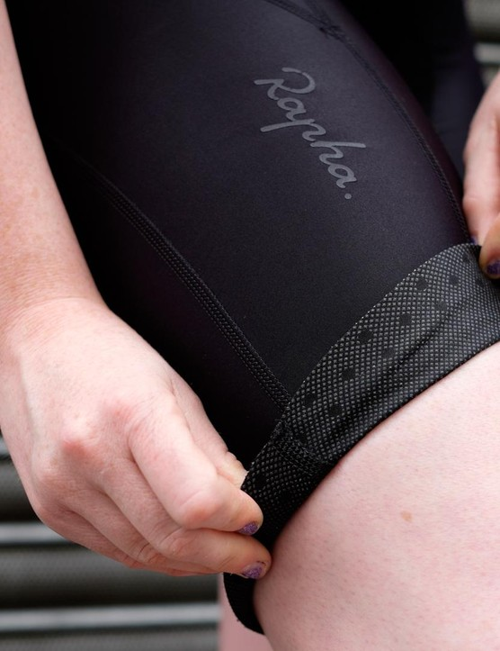 The wide hems on the leg are backed with minuscule silicone dots to help grip the leg and keep the shorts in place