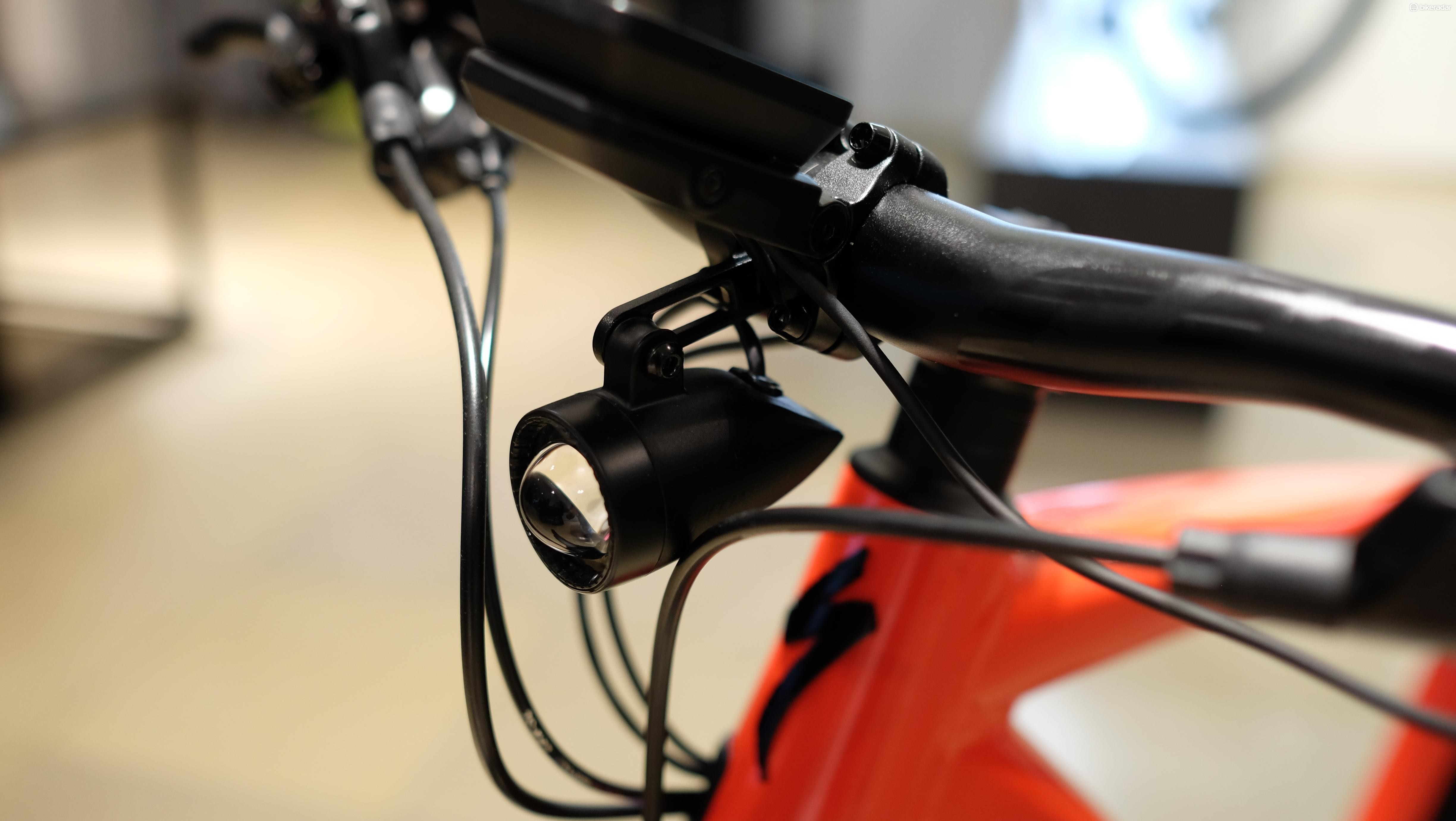The Turbo Vado's front light, complete with its distinctive aspherical lens