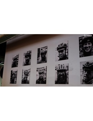 Faces of Land Run adorn a wall inside District Bicycles