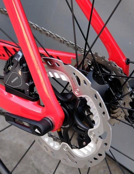 The DT-Swiss thru-axle and flat-mount brake calipers make for a neat and secure rear end