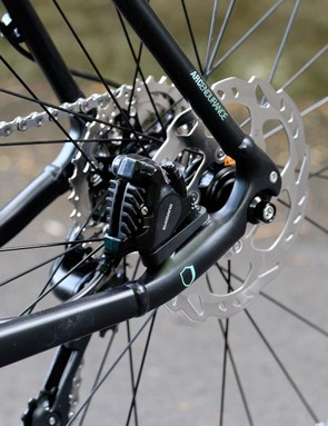 Flat-mount rear end is secured by a bolt-on 9mm axle