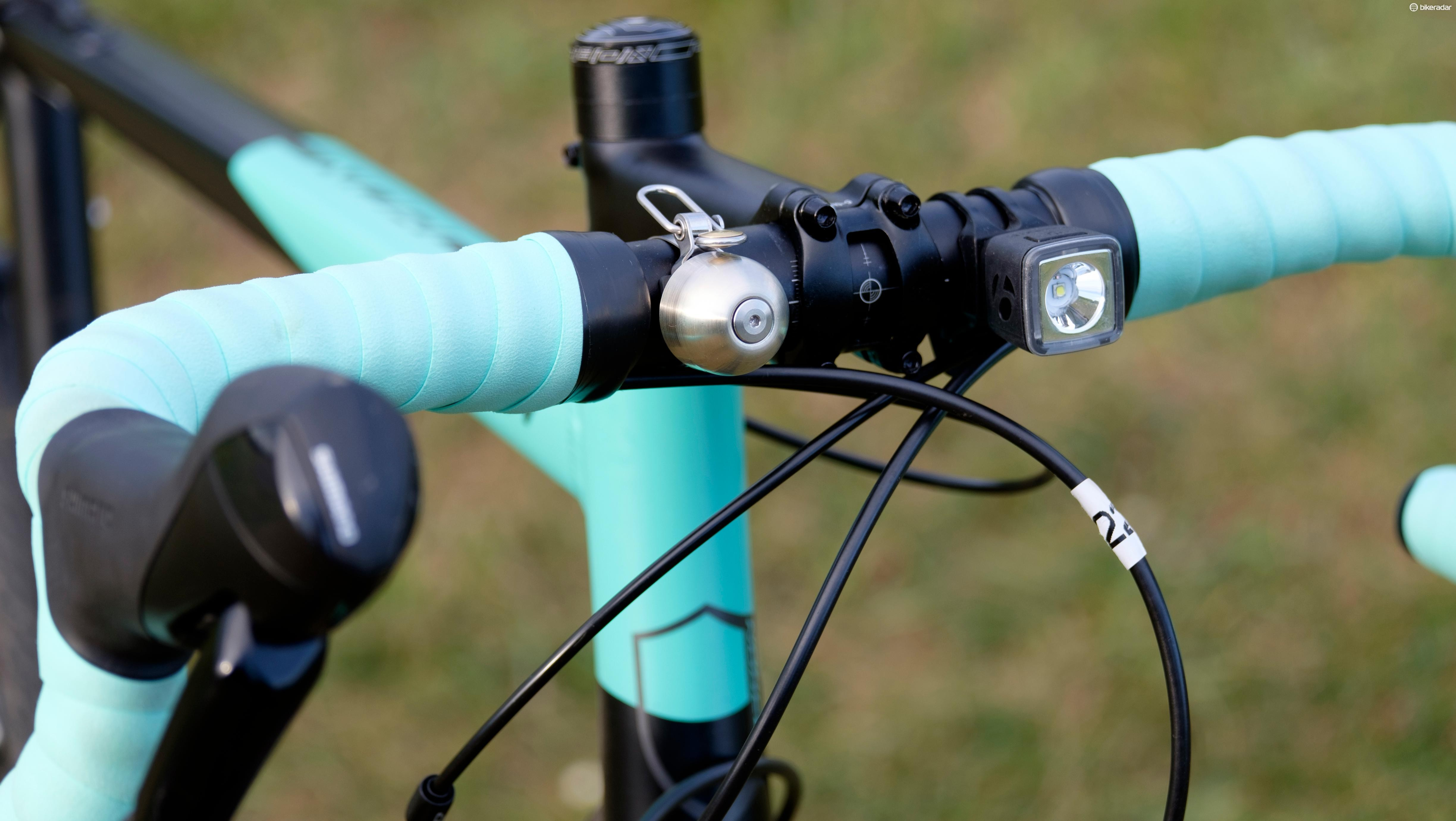 Spurcycle's very fancy and exceedingly expensive bell (L) and Bontrager's trusty Ion 100 R front light (R)