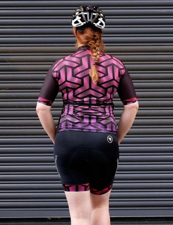 The jersey features three pockets on the rear plus a side pocket
