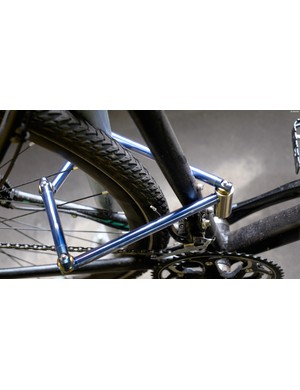 The lock is designed to work through the frame and rear wheel